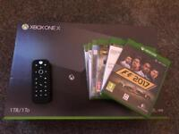 Xbox one X with 6 Xbox one X with 6 games, 3 still sealed and media remote