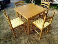 Beech wood extending dining table with 4 matching chairs