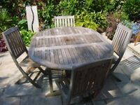 Solid Teak Garden table and four chairs