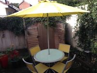 Round Garden Table With 4 Folding Chairs and Matching Parasol