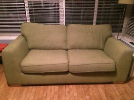Green 3 seater DFS fabric couch. 2 years old