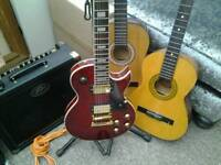 Rockburn electric guitar + 2 free acoustic guitars
