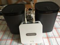 Pair of Sonos Play1 Speakers + bridging unit.