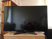 "32"" FLAT SCREEN TELEVISION + HDMI cable"