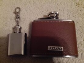 Two hip flasks one leather bound and the other is small stainless steel on a key ring.