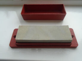 6 inch SHARPENING STONE in PLASTIC HOLDER, HARDLY USED, (can be attached to a workbench)