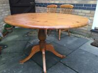 Solid pine oval table and two chairs