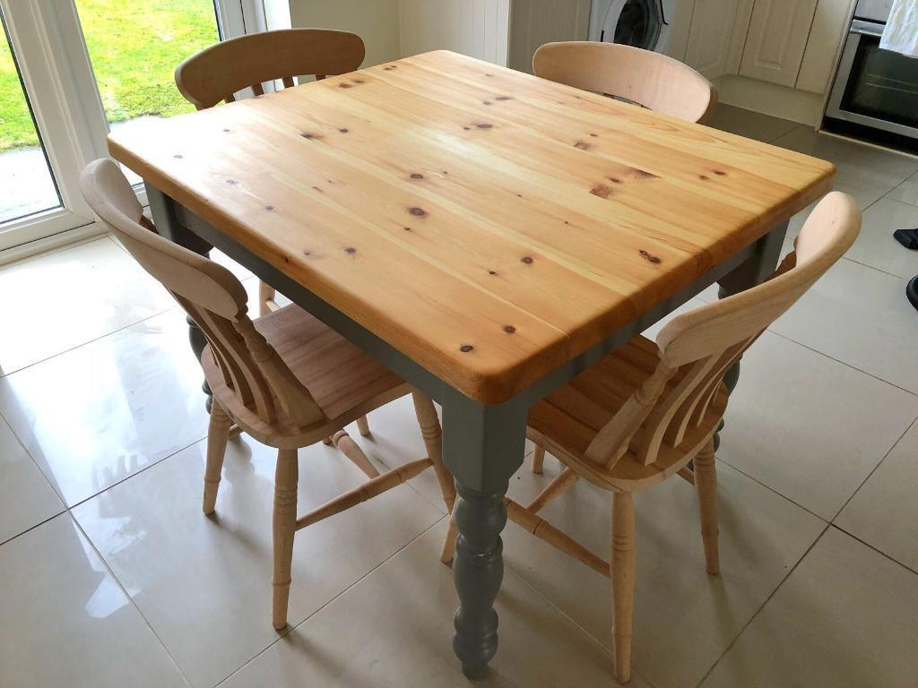 Solid pine table and 4 chairs. Less than one year old. Legs painted Farrow & Ball grey.