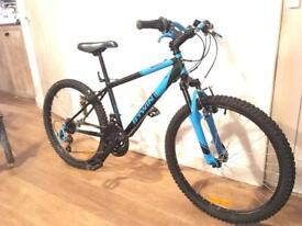 B twin rockrider 500 child's mountain bike with suspension , new. 24 inch frame and wheels.