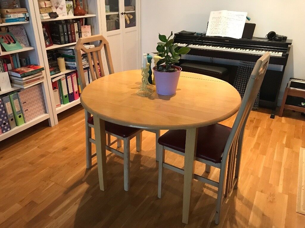 Round wooden dining table and two chairs, £50 ono