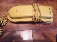 Old style yellow phone corded