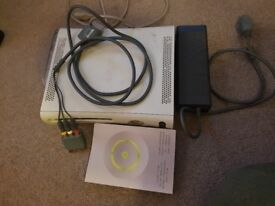 X box 360 console with games and controllers