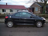 55 plate black peugeut convertable hard top great condition inside brill for those sunshine days
