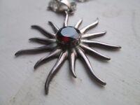Sunburst garnet pendant