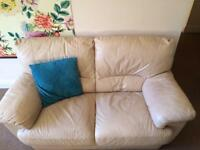 Cream/yellow leather two seater sofa for sale