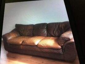Large leather sofa used condition but still very comfy free to anyone that can collect