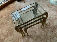 Set of three glass and gold coffee tables