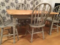 Rustic scrubbed pine table with four matching chairs