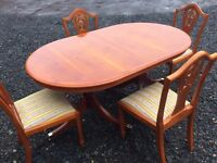 Gorgeous extending dining table and four matching chairs