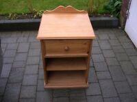 A single drawer pine bedside cabinet.