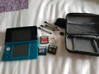 Nintendo 3DS console with games