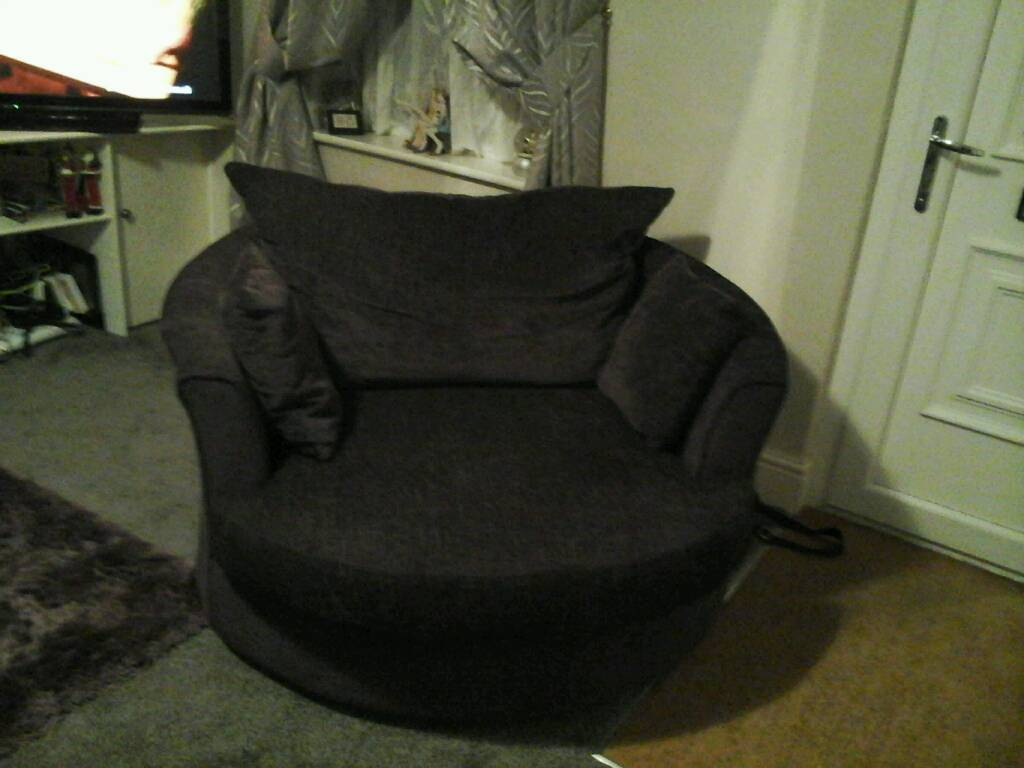 Large settee with footstool and large swivel armchair
