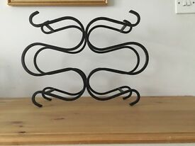 Cast iron wine rack holds up to 8 bottles