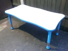 Adjustable kids table, few marks, open any offers.