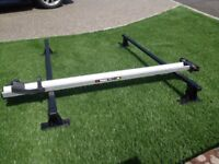 Thule Pro bicycle roof carrier with Thule classic roof bars.