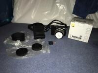 Nikon 1 J5 mirror less camera. + 2 lenses. Used once for a wedding.