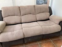 Leather sofa with fabric cushions and backs