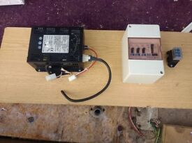 Caravan battery charger and consumer unit