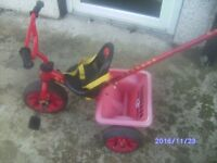 Trike with safety straps and steering handle
