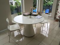 Designer White round table (Dwell). White gloss solid table.
