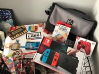 NINTENDO SWITCH BUNDLE!4 MONTHS OLD!USED TWICE!