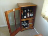 Cupboard with one shelf and hinged door.