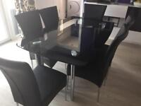 Glass 6 seater Dining Table and Chairs