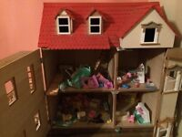 wooden doll's house. hardly used. outside painted