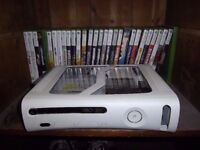 XBOX 360 WITH ABOUT 20 GAMES.