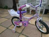 Girls starter bike with stablezers hardly been used very good condition