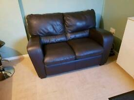 2 seater . Leather rocking chair.