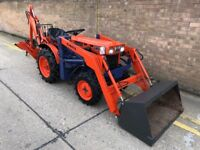 Kubota b6100 compact tractor/ front loader and back hoe