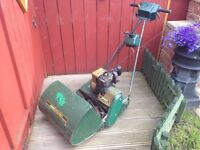 qualcast suffolk punch petrol lawnmower good starter comes with spare pull start bargain only £40