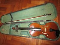 Student Viola with bow in antique wooden case.