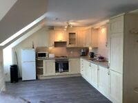 Two bedroom loft style new build apartment with private parking at The Shore available now!