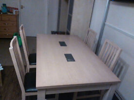 Dining table and 4 chairs. Good condition, some scuffs on table top. Leather seat chairs