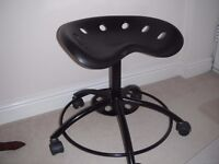 Black plastic and metal chair on wheels in perfect condition