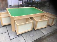 Children's play table with storage boxes