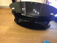 Oval black gloss tv stand