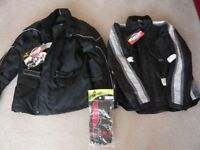 TWO MOTORCYCLE JACKETS + GLOVES. ALL NEW SIZE LARGE.